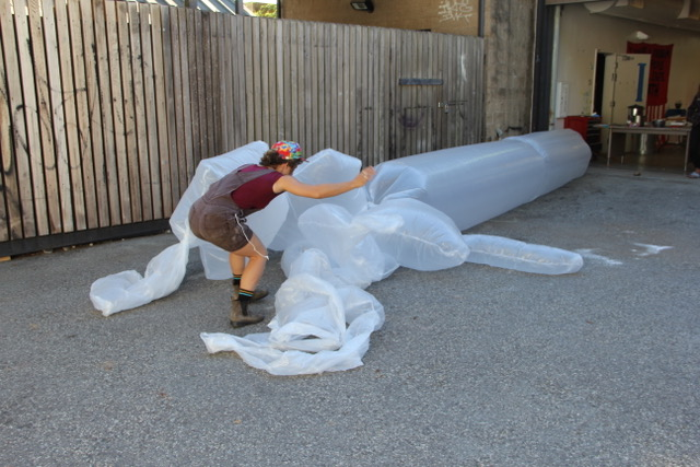 Image of student inflating artwork