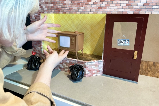 Artist Kalen Meeks with their stop motion animation set