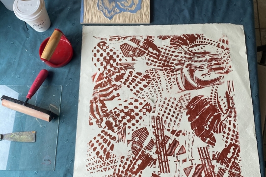 Abby McPhillips working on a relief print
